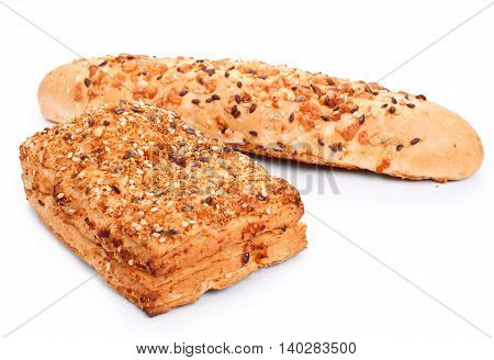 Pair of spicy bun sprinkled with sesame seeds isolated on white