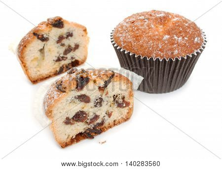 Halves Of Homemade Muffins With Raisins, And The Whole Muffin Close-up. Isolated On White Background