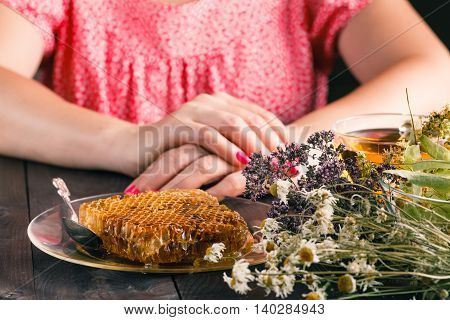 Woman Hands With Cup Of Fresh Herbal Tea On Wooden Table. Selective Focus, Horizontal.