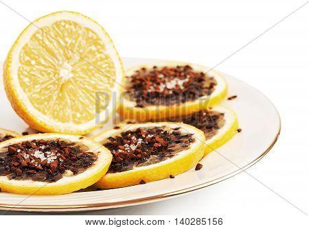 Sliced lemon. Lemon with coffee and sugar.