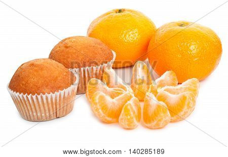 Tasty cupcakes and fresh ripe tangerines, with slice of mandarin isolated on white background, close-up.