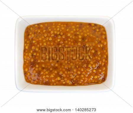 Mustard In A Ramekin, Isolated Against White Background. Close-up, Top View.