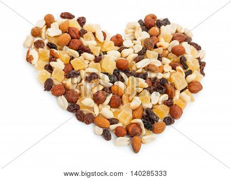 Mixture Of Nuts And Candied Fruits Isolated On A White Background. Fruit Mix In The Shape Of A Heart