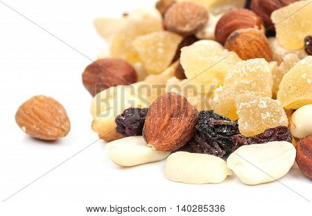 Mixture Of Nuts And Candied Fruits Isolated On A White Background. Fruit Mix Close-up.