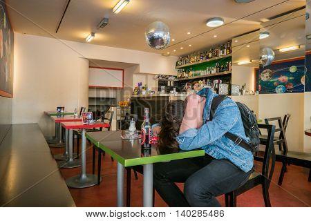 Brno, Czech Republic - April 30, 2016: Young drunk man sleeping in a bar