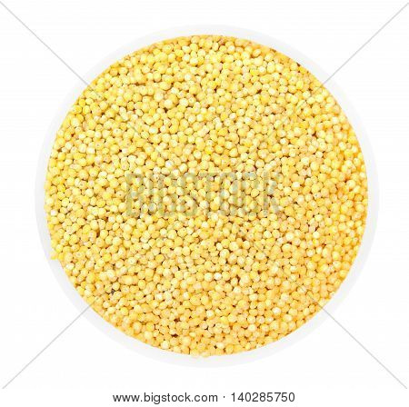 Heap Of Millet Groats In Round Plate Isolated On White. Top View.
