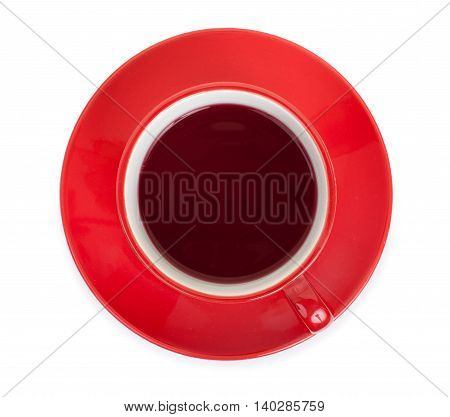 Red cup on a red saucer with red tea isolated on a white background top view.