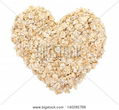Rolled Oats Laid Out In The Shape Of Heart Isolated On White. Top View.