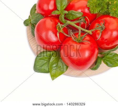 Branch Of Fresh Tomatoes With Water Drops On A Round Woden Board Isolated On White Top View