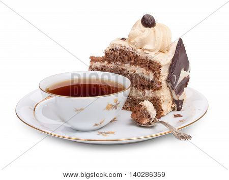 A Piece Of Chocolate Cake On A Round Plate With A Cup Of Tea And A Teaspoon, Close-up.
