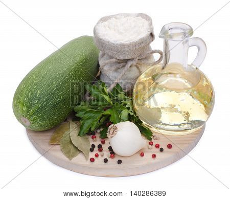 Green Zucchini, Garlic, A Bottle Of Vegetable Oil, Bag With Flour, Parsley, Bay Leaves, Mixed Pepper