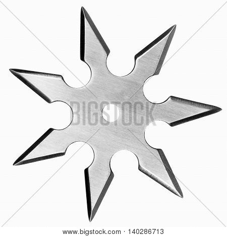 Silver colored metal shuriken isolated on white background.