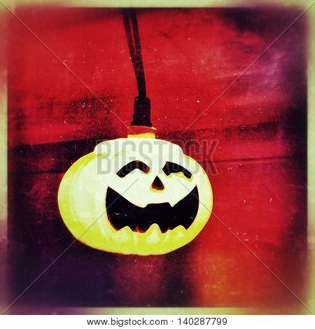 Halloween jack o lantern pumpkin light decoration toned with a retro vintage instagram filter app or action