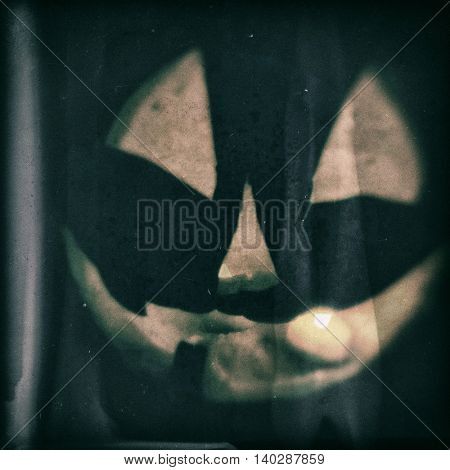 vintage style image of a Halloween jack o lantern toned with a retro vintage instagram filter app or action