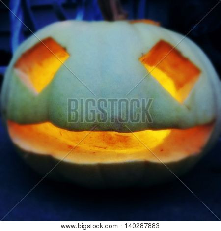 Halloween jack o lantern glowing in the night -  Instagram filter effect