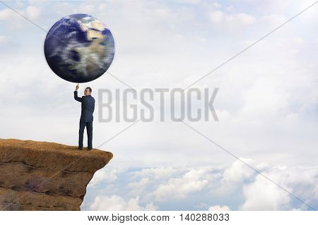 global environmental business concept businessman spinning earth on one finger