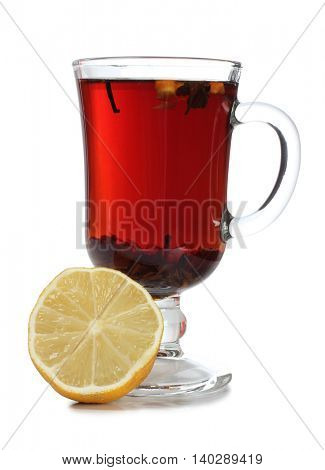 Glass cup with tea and a lemon on a white background