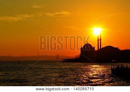 Mosque silhouette Istanbul on sunset, Cityscape image in Istanbul Turkey at sunset. Bosporus sunset.