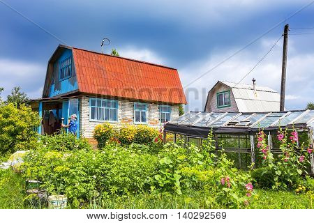 Berdsk vacation village Novosibirsk oblast Siberia Russia - July 17 2016: a Suburban area with a house built during the times of the Soviet Union