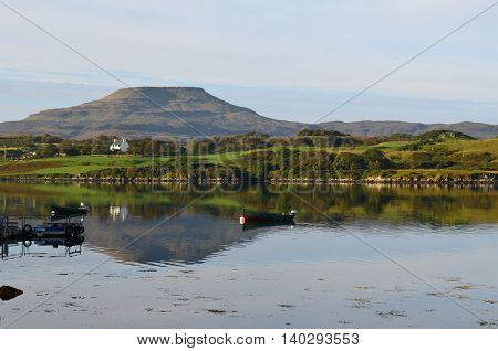 Gorgeous view of MacLeod's Table reflecting in the loch near Dunvegan.