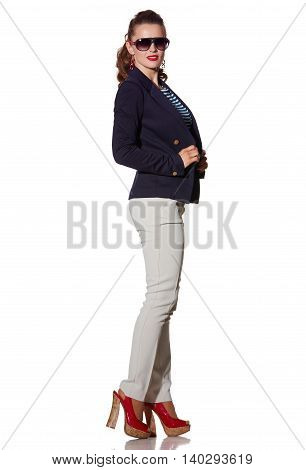 Young Woman In Sunglasses Standing On White Background