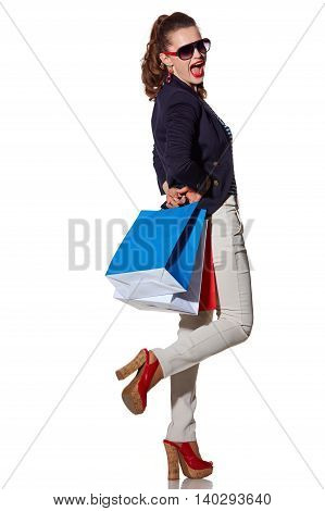Woman With Shopping Bags In Sunglasses Having Fun Time On White