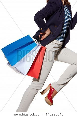 Cheerful Woman With Shopping Bags In Sunglasses On White