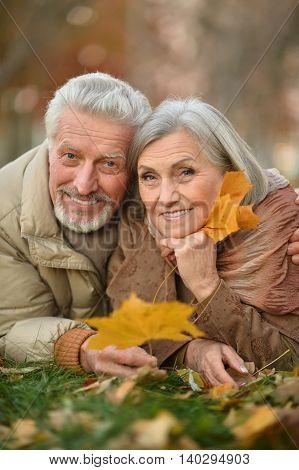 happy beautiful Senior couple in autumn park