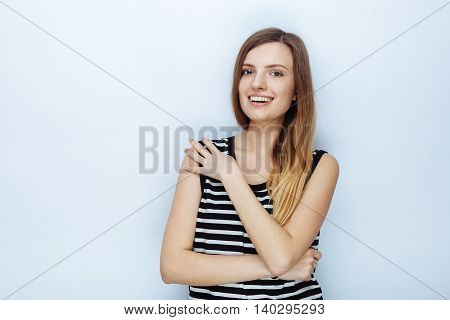 Portrait Of Happy Young Beautiful Woman In Striped Shirt Touching Her Shoulder Posing For Model Test