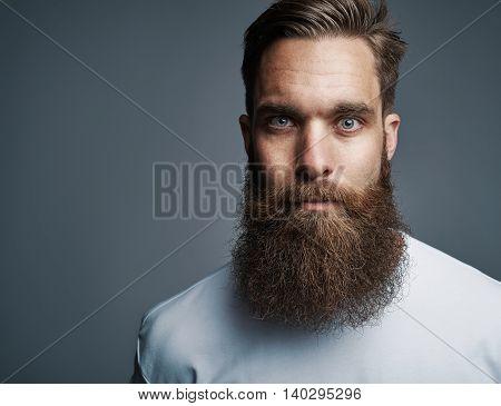 Close Up On Serious Man With Long Beard