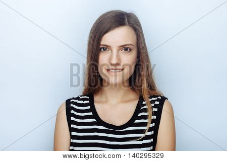 Portrait Of Happy Young Beautiful Woman In Striped Shirt Biting Her Lip Posing For Model Tests Again