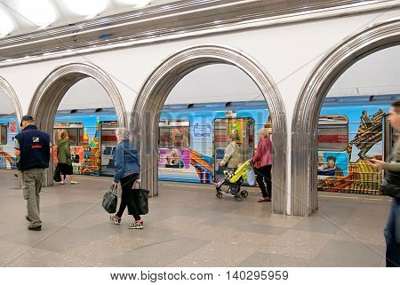 Saint - Petersburg, Russia - July 20, 2016: People walk on the platform near train -