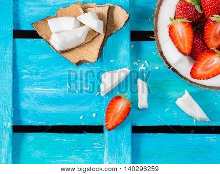 Coconut And Strawberries On Blue Background