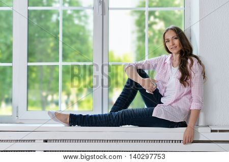 Happy young woman with tea  at home