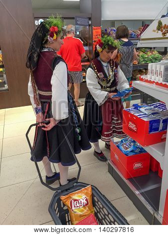 KAZANLAK, BULGARIA - JUNE 05, 2016: Women in national dress are shopping in the supermarket. After the Rose Festival.