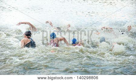 Triathlon Cup of Ukraine and Cup of Bila Tserkva. July 24 2016 in Bila Tserkva Ukraine. Swimming part. Start. Back view.
