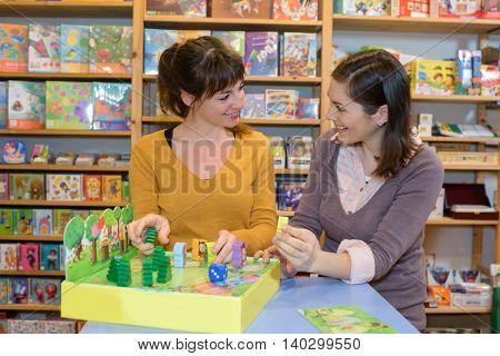 two female friends buying toys for their kids