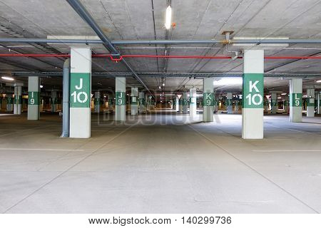 An empty underground car park during the day without cars