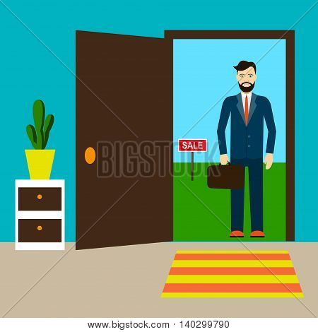 Real estate agent standing in the doorway of the house which is for sale