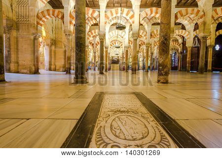 Cordoba, Andalusia, Spain - April 20, 2016: the popular columns inside the Great Mosque Cathedral of Cordoba.