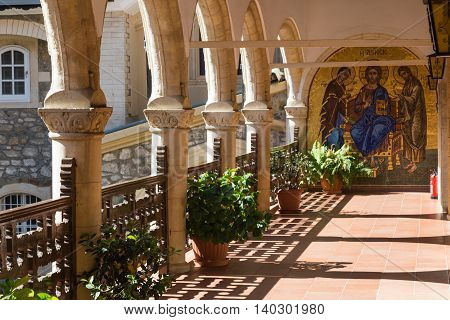 Holy Monastery of the Virgin of Kykkos. Cyprus. Stone arched balcony with painting on wall