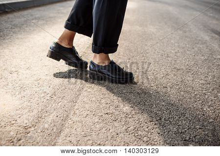 Close up photo of businesswoman's legs step.