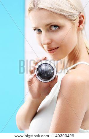 Ball massage, relaxation massage. Woman performs massage ball massage.