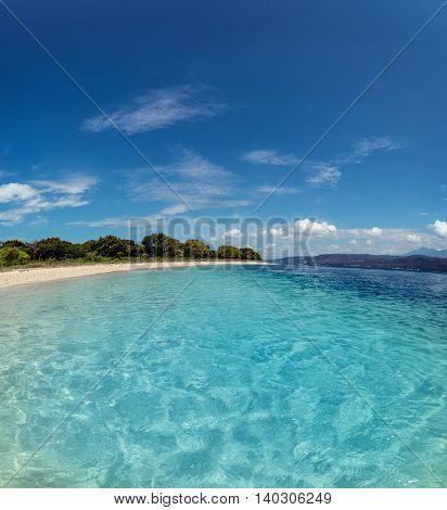 Sandy beach and clear tropical sea at sunny day. Bali, Indonesia