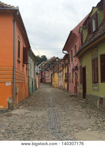 Romania, August 21, 2015, Sighisoara, Transylvania, View over an old town narrow street