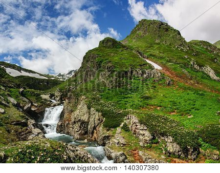 Summer mountain landscape with river and waterfall. Georgia.