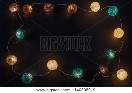Electric garland with wire balls on a dark background