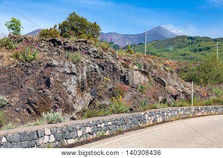Mountain road to top of Etna volcano at Sicily island Italy