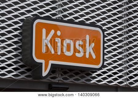 Orange neon  lighting display with the text kiosk