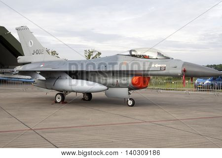 LEEUWARDEN, NETHERLANDS - JUNI 11 2016: Old F16 fighter jet of the Dutch air force. This aircraft is replaced by the F35 fighter jet